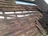 Exposed timberwork shows failed featheredge boarding
