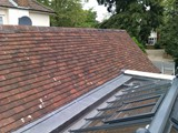 Re-roof of garage in small clay tiles